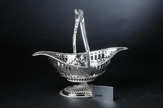 VICTORIAN SILVER PLATED CAKE BASKET. Circa 1870. - 6 1/2 in. high x 14 1/4 in. long;.