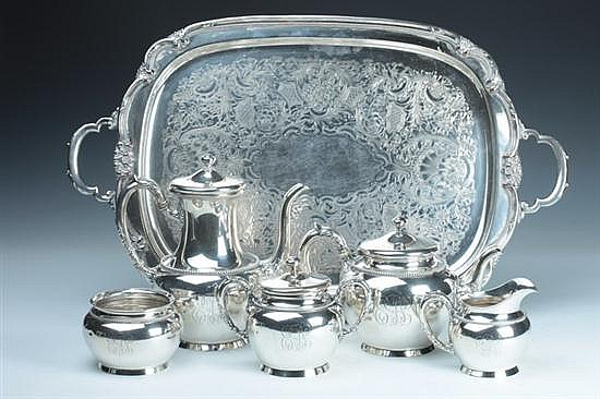FOUR-PIECE MERIDEN BRITANNIA CO. STERLING SILVER TEA AND COFFEE SERVICE. - 54 oz., 2 dwt., weighable silver; 9 in. high, coffee pot.