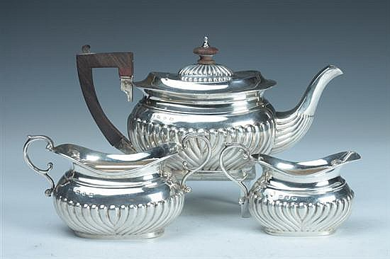 THREE-PIECE VICTORIAN SILVER TEA SET, A & J Zimmerman, Birmingham, 1897. - 9 oz., 2 dwt., total weight; 4 3/4 in. high, teapot.