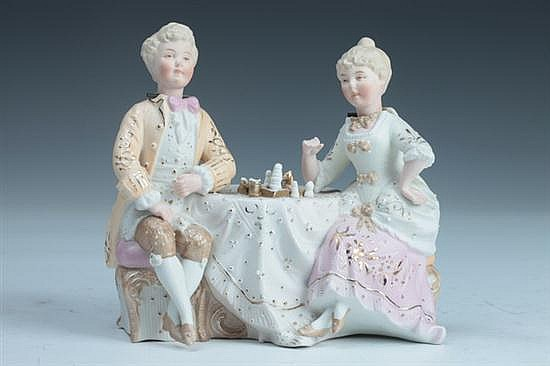 BISQUE PORCELAIN NODDING HEAD FIGURAL GROUP, 20th century. - 5 1/4 in. high.