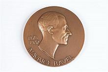 PIERRE-MARIE POISSON (French, 1876-1953). MAURICE RAVEL, Bronze relief medallion.