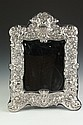 STERLING SILVER-MOUNTED MIRROR, 19th-20th century; RC, possibly for Robert Campbell, Baltimore. - 21 1/2 in. x 16 1/4 in., overall.