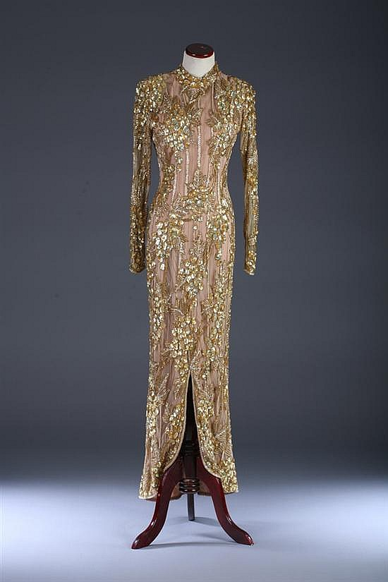 BOB MACKIE GOLD-SEQUINED EVENING GOWN, Circa 1980s; Bob Mackie and Elizabeth Arden The Salon labels.