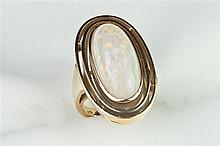 14K YELLOW GOLD AND PRECIOUS WHITE OPAL RING, by Charles Ernst, Washington, DC (signed). - Size 4 1/2.