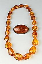 TWO ITEMS GOLDEN TRANSPARENT AMBER JEWELRY,