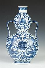 CHINESE BLUE AND WHITE PORCELAIN DOUBLE GOURD VASE, Qianlong underglazed blue seal mark. - 12 1/2 in. high.