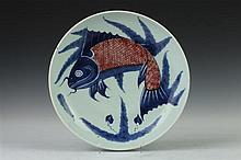 CHINESE BLUE AND COPPER RED PORCELAIN DISH, 19th Century. - 11 in. diam.