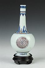 CHINESE COPPER RED AND BLUE PORCELAIN BOTTLE VASE, Chenghua six-character mark, Qing Dynasty. - 8 1/4 in. high.