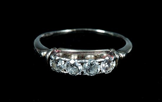 CONTINENTAL WHITE GOLD AND DIAMOND BAND,