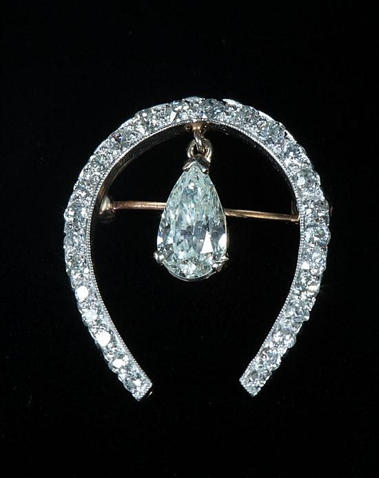 EDWARDIAN PLATINUM-ON-YELLOW GOLD AND DIAMOND HORSESHOE PIN.