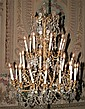 CONTINENTAL TRANSITIONAL STYLE GILT-METAL AND CRYSTAL 32-LIGHT CHANDELIER, 20th century. - H: 48in. x D: 36 in.