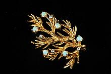 18K YELLOW GOLD, PRECIOUS WHITE OPAL AND DIAMOND TEXTURED BRANCH PIN. - L: 2 1/4 in.