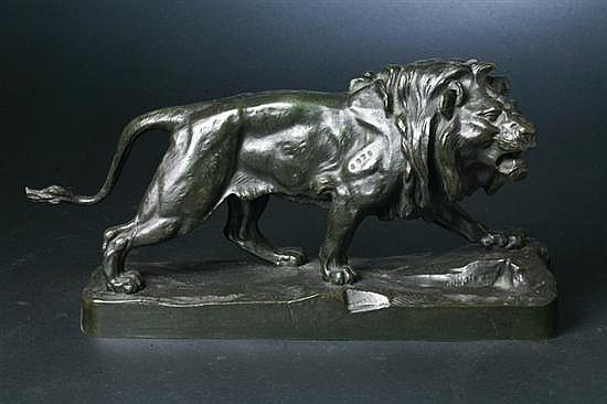 AFTER PAUL THOMAS, (French, 1859-1910). LION MARCHANT, Bronze; signed P. Thomas.