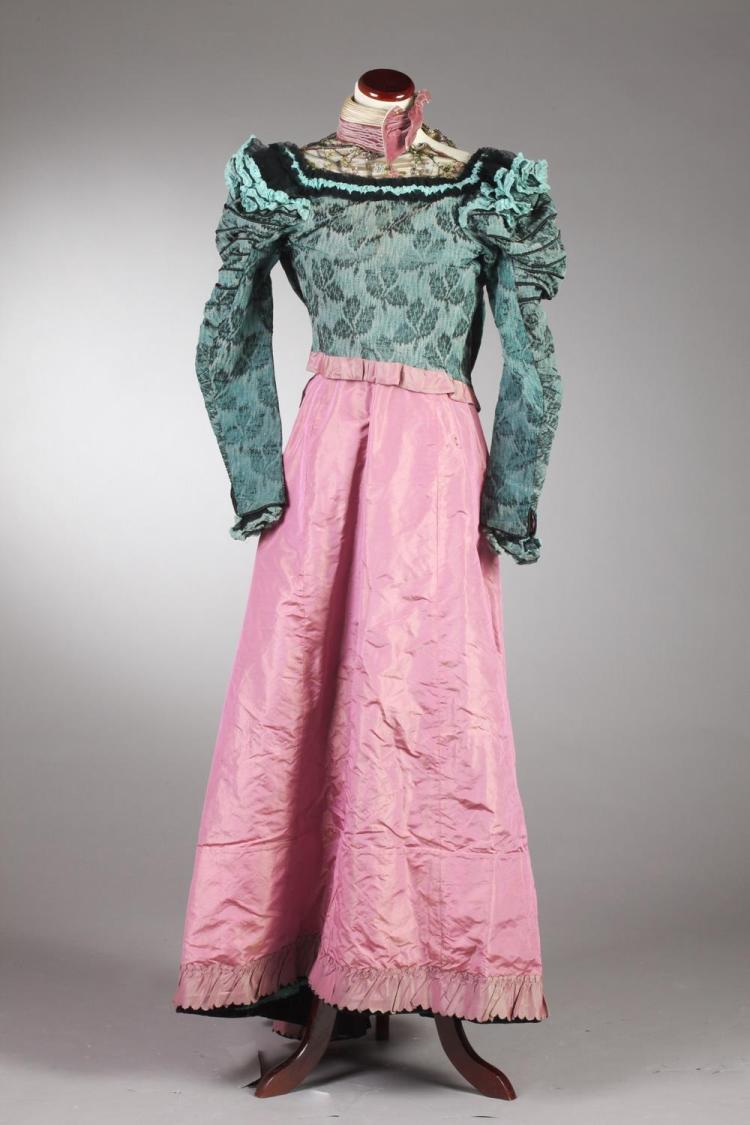 VINTAGE BLUE SILK BROCADE JACKET AND MAUVE TAFFETA SKIRT, Circa 1895; Mrs. L. Graves, Robes, Buffalo, NY label.