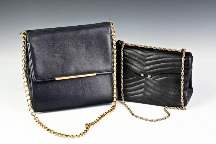 TWO VINTAGE BLACK LEATHER HANDBAGS.