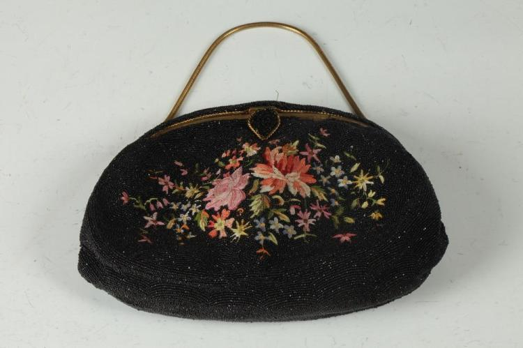 VINTAGE BLACK BEADED PURSE WITH RED, PINK AND YELLOW FLORAL MOTIF IN CENTER.