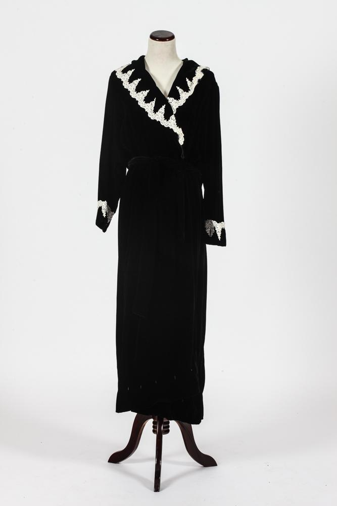 CHRISTIAN DIOR WHITE LACE TRIMMED FULL LENGTH BLACK VELVET DRESSING GOWN.