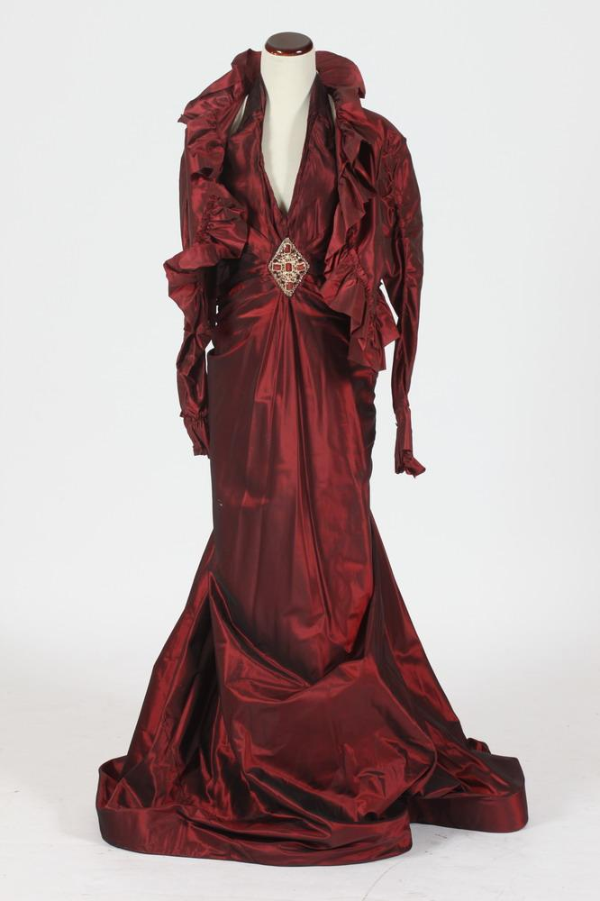 FORMAL GOWN AND MATCHING JACKET IN BORDEAUX-COLORED SILK WITH GOLD-TONE BROOCH ATTACHED AT WAISTLINE. size medium.