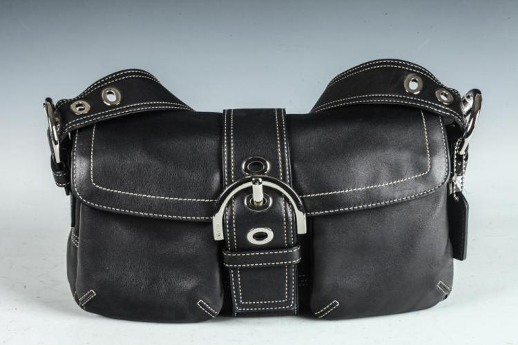 COACH BLACK LEATHER BAG .