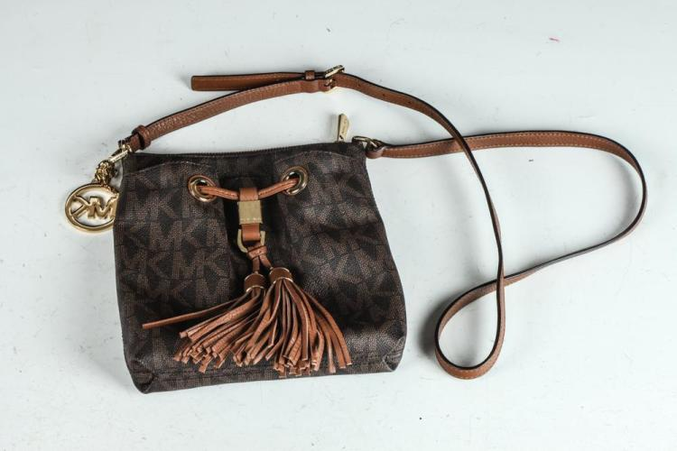 MICHAEL KORRS DARK BROWN BAG WITH LIGHT BROWN MK MOTIF AND TAN TASSLE WITH GOLD-TONE DETAIL.