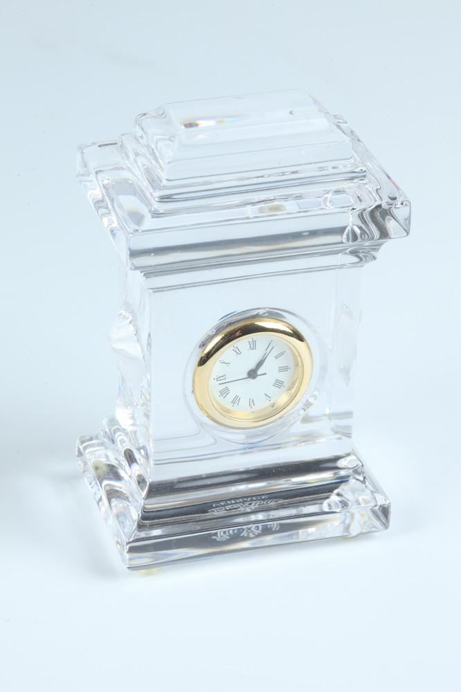 VERSACE MINIATURE GLASS CLOCK WITH GOLD-TONE RIMMED CLOCK FACE.