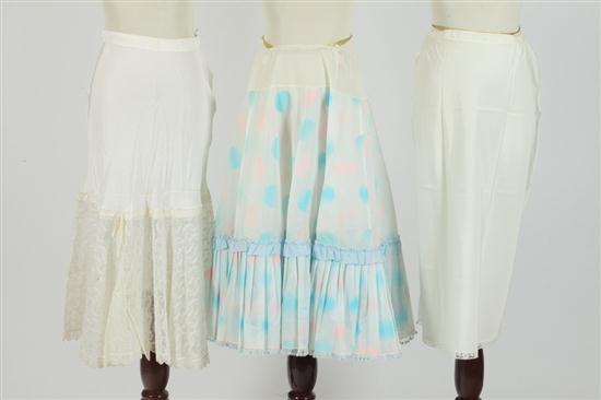 THREE VINTAGE UNDERSKIRTS: 1 WITH PINK AND PALE BLUE POLKA DOTS; 1 WHITE CRINOLINE WITH NETTING; 1 PLAIN,