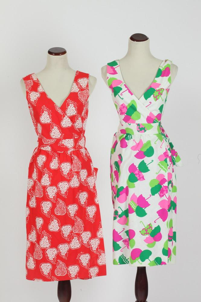 TWO VINTAGE COTTON DRESSES: 1 PINK, GREEN AND WHITE WITH UMBRELLA MOTIF; 1 RED AND WHITE WITH PEAR MOTIF, Size 8. Made in Honolulu.