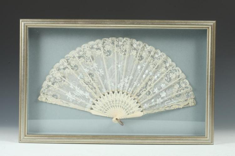 WHITE LACE FAN FRAMED IN SILVER-TONE BOX WITH PALE BLUE BACKGROUND.