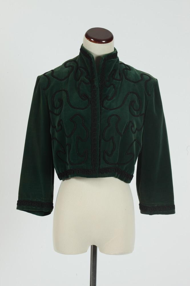VINTAGE 1950'S EMERALD GREEN VELVET BOLERO JACKET WITH BLACK BRAID TRIM, Argentina, size small.