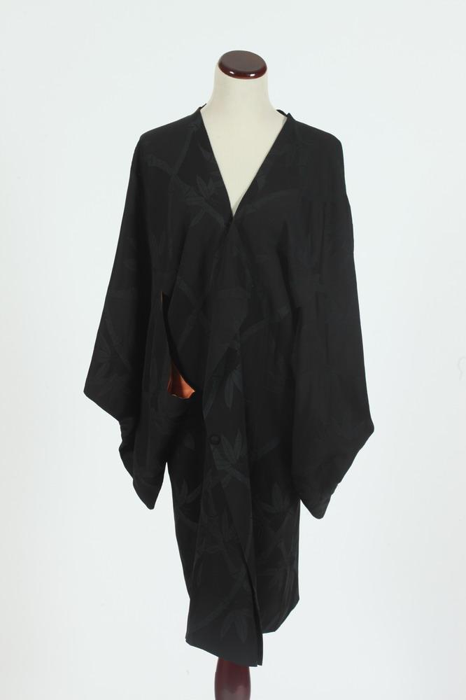 VINTAGE BLACK ISETAN SILK KIMONO-STYLE JACKET WITH ORANGE SILK LINING. Tokyo, size medium.