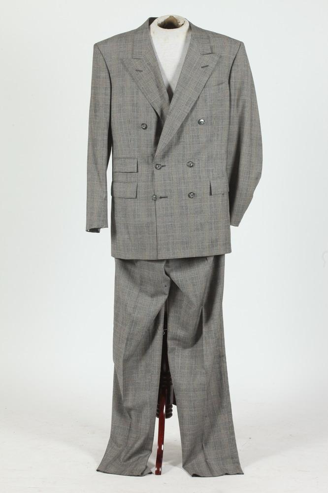 MEN'S BLACK AND WHITE DOUBLE-BREASTED PLAID SUIT. (MISSING BUTTONS ON SLEEVE CUFFS), size 42T, made in Canada.