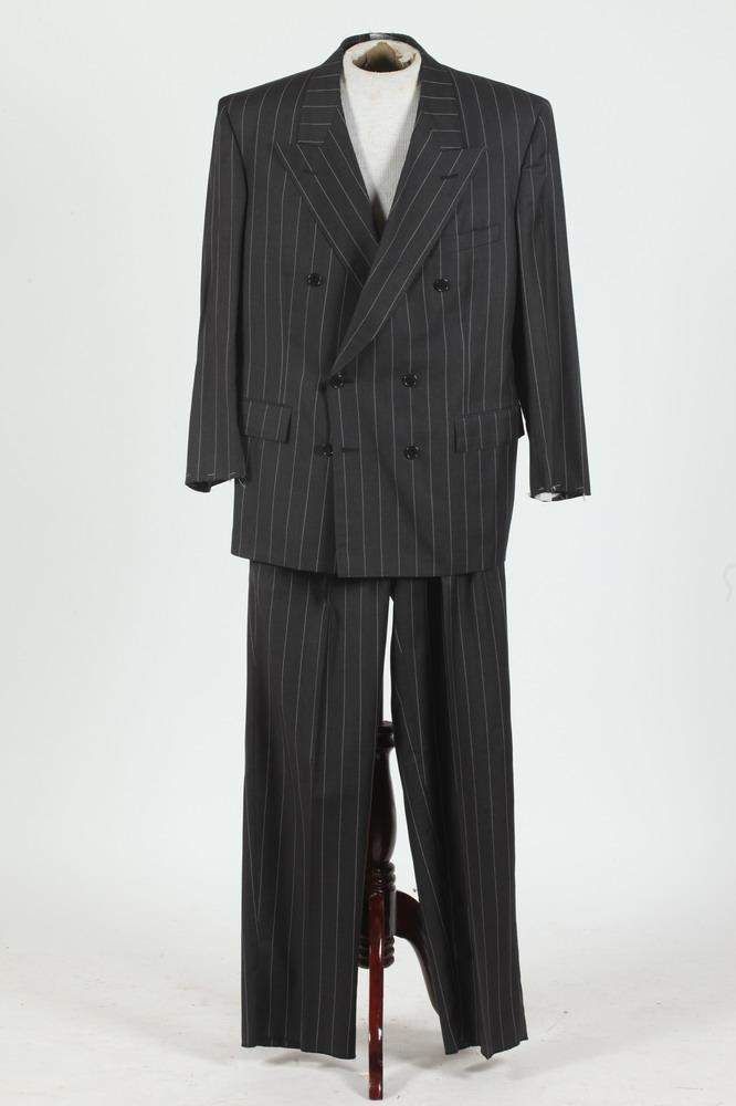 MEN'S BLACK WOOL DOUBLE-BREASTED SUIT WITH WHITE PINSTRIPES. (MISSING BUTTONS ON SLEEVE CUFFS), size 42s.