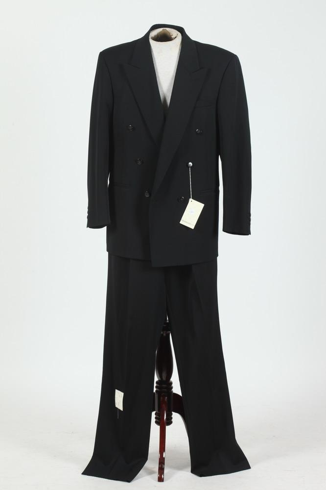 MEN'S BLACK WOOL DOUBLE-BREASTED SUIT WITH COURRÈGES LABEL, size 40 long.