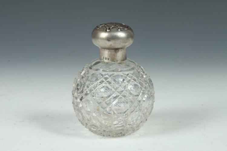 VINTAGE CRYSTAL PERFUME BOTTLE WITH STERLING SILVER TOP WITH REPOUSSE TOP, 1920's.