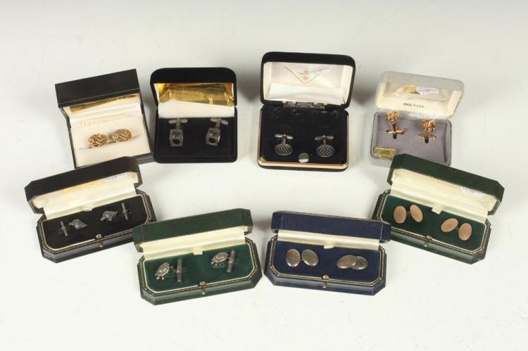 MEN'S ACCESSORIES: GOLD-TONE AND SILVER CUFFLINKS.