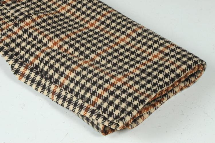 RUST, BLACK AND CREAM HOUNDSTOOTH WOOL FABRIC.