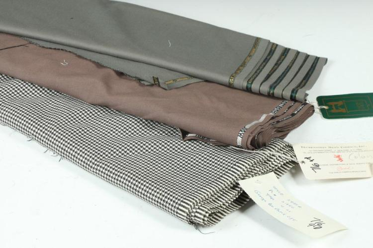 THREE BOLTS OF FABRIC: ONE BLACK AND WHITE HOUNDSTOOTH; ONE GREY BLUE AND MAUVE.
