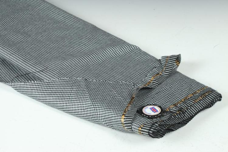 BLACK AND WHITE HOUNDSTOOTH WOOL FABRIC.