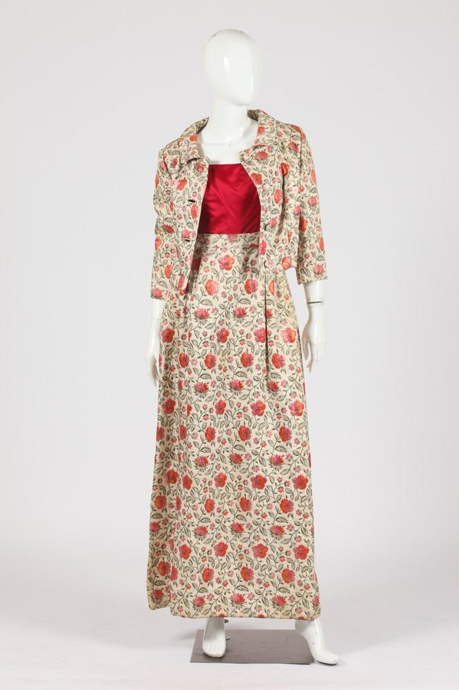 VINTAGE MAGENTA SLEEVELESS TOP ATTACHED TO LONG SKIRT WITH CROPPED JACKET; FLORAL PATTERN ON CREAM BACKGROUND.