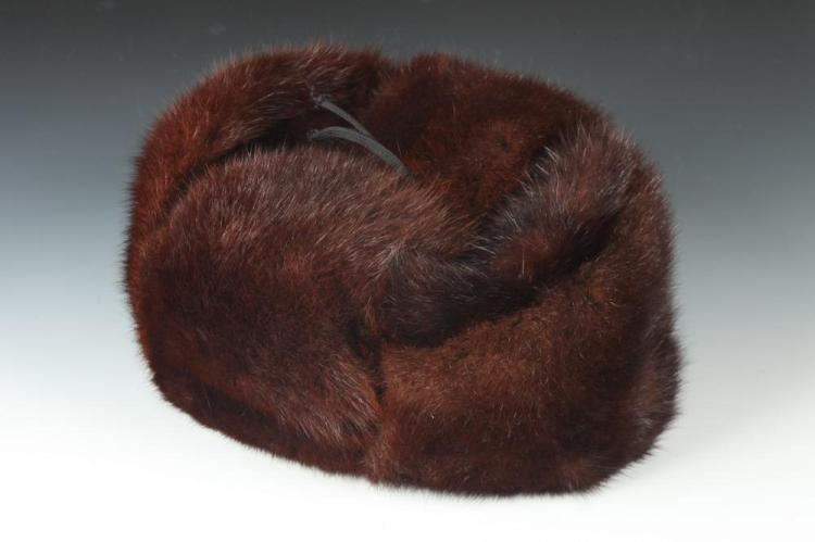 BROWN FUR HAT WITH EAR FLAPS. Size small.