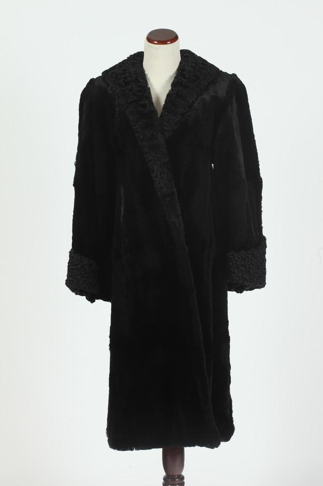 BLACK SEA LION COAT WITH PERSIAN LAMB TRIM. Clifford Fur Rochester, New York. Size large.