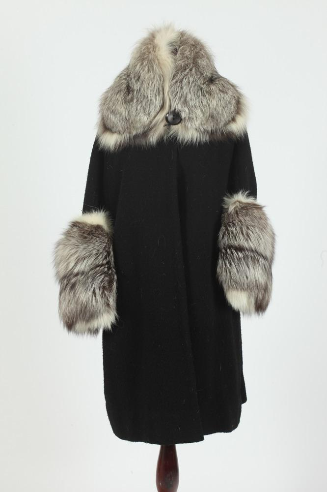 VINTAGE BLACK WOOL COAT WITH RACOON TRIM ON CUFFS AND COLLAR.