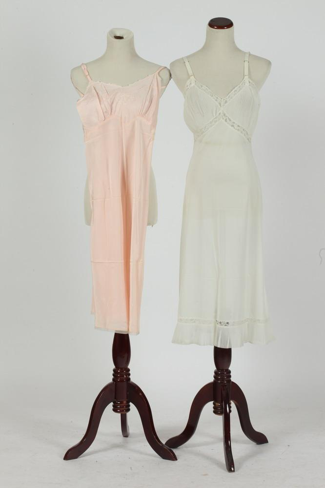 TWO VINTAGE KNEE-LENGTH NUISSETTES: ONE PINK; ONE WHITE, size small.