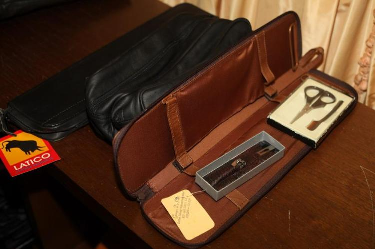 LEATHER TRAVEL ACCESSORIES: TWO TIE CASES.
