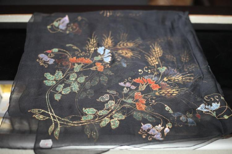 VINTAGE BLACK MUSLIN SCARF WITH HAND-PAINTED FLORAL MOTIF IN GOLD, BLUE AND PINK, 1930's,