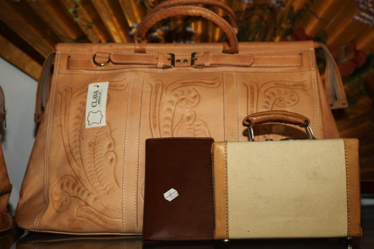 LARGE LEATHER SATCHEL; SMALL BEIGE CANVAS MINI SUITCASE WITH TAN LEATHER TRIM; BROWN LEATHER WALLET.