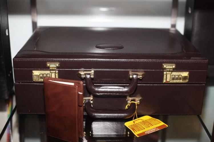 DARK BROWN LEATHER BRIEFCASE AND SMALL CALCULATOR CASE,
