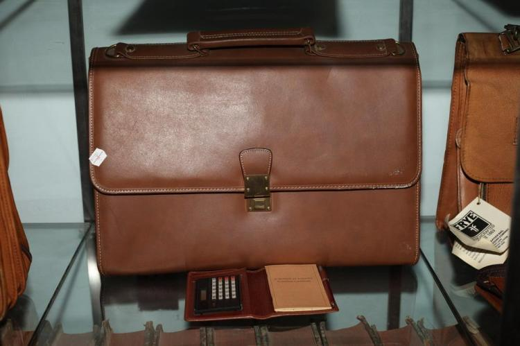 CINNAMON LEATHER BRIEFCASE WITH MATCHING CALCULATOR CASE.