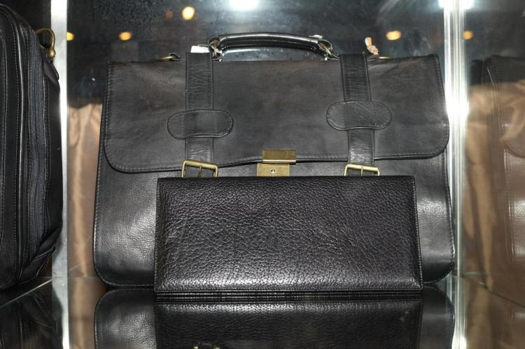 BLACK LEATHER BRIEFCASE WITH GOLD-TONE BUCKLES; ONE BLACK LEATHER CARD CASE,