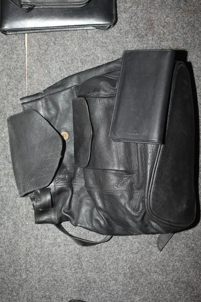 BLACK LEATHER BACKPACK WITH TWO SMALL BLACK LEATHER ITEMS,